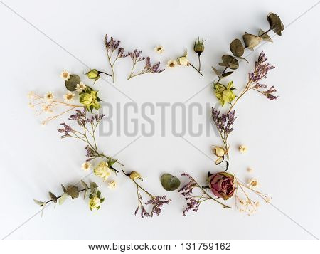 Frame of dry flowers background. Flat lay