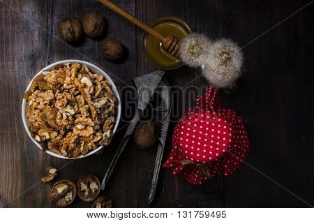 Bowl with walnut still life dark photo