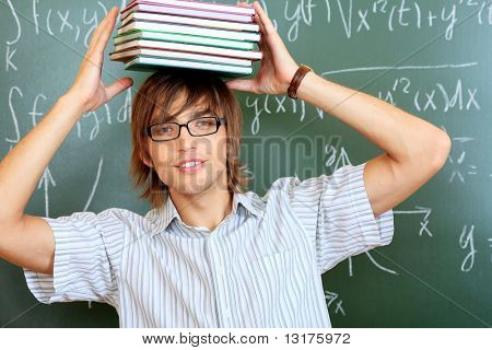 Educational theme: male student in a classroom.
