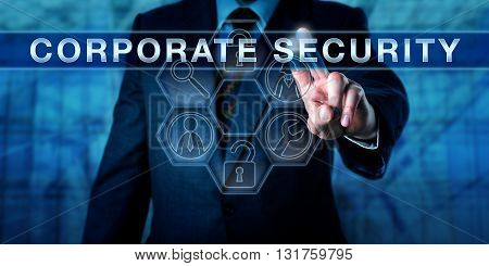 Business manager is touching CORPORATE SECURITY on a virtual interactive control screen. Information technology metaphor and physical security concept. Symmetrical composition with tool icons.