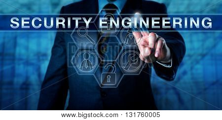 Manager is pressing SECURITY ENGINEERING on a virtual interactive touch screen interface. Business metaphor for physical security and information technology concept for computer security.