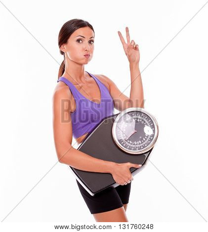 Healthy Pouting Brunette With A Scale
