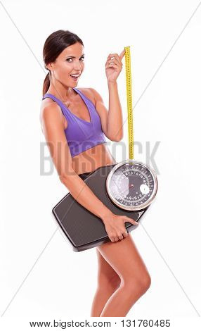 Healthy Smiling Brunette With A Scale