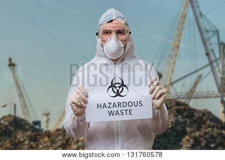 Technician In Coverall In Landfill Warns Against Dangerous Hazar