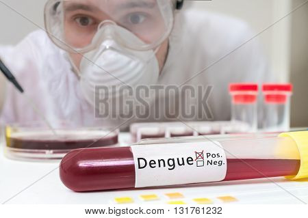 Scientist In Overall Is Analyzing Blood Sample In Test Tube For