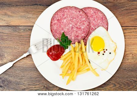 French Fries with Scrambled Eggs, Ham, Ketchup Studio Photo