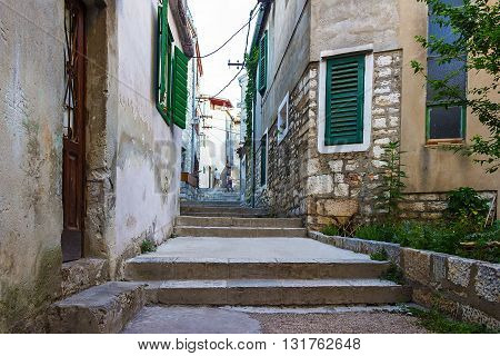 Narrow old streets and yards in Sibenik city Croatia medieval zone