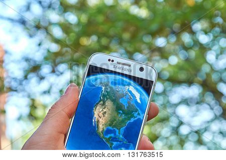 MONTREAL CANADA - MAY 23 2016 : Google Earth application on Samsung S7 screen. Google Earth is a virtual globe map and geographical information program that was originally called EarthViewer 3D.