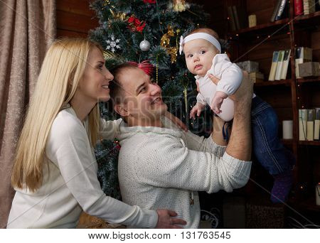 photo of happy family in christmas decorated room