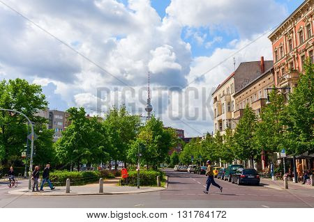 Berlin Germany - May 15 2016: street view at Prenzlauer Berg with unidentified people. Since 1920 Prenzlauer Berg was a Berlin district. 2001 it was incorporated into the district of Pankow