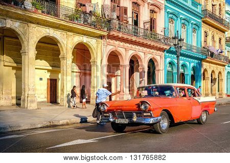 HAVANA,CUBA - MAY 26,2016 : Street scene with old car and colorful buildings in Old Havana