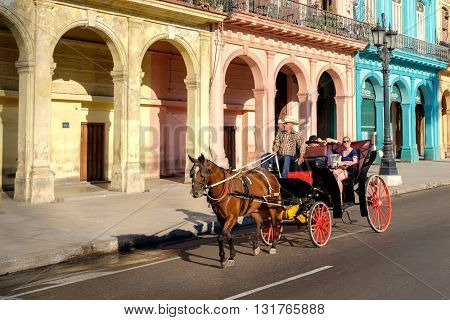HAVANA,CUBA - MAY 26,2016 : Group of tourists riding a horse carriage in Old Havana