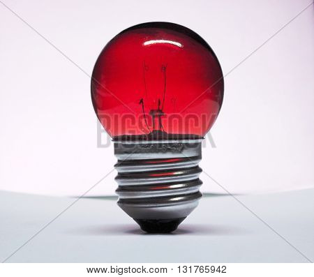 red incandescent lamp light bulb isolated on white background