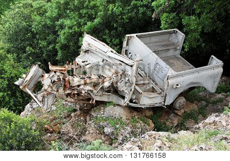 BANIAS FALLS, GOLAN HEIGHTS, ISRAEL, 30 MARCH 2013. Editorial Photograph of Destroyed Military Vehicle Left As War Memorial, Bearing Plaque Marking End Date of Israel's Six Day War