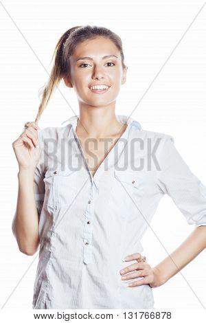 cute young pretty girl thinking on white background isolated close up smiling, messing with hair, gesturing