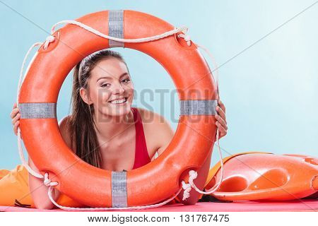 Lifeguard Woman On Duty With Ring Buoy Lifebuoy.