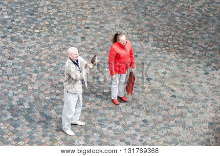 Tourist Couple Taking Shot Or Video