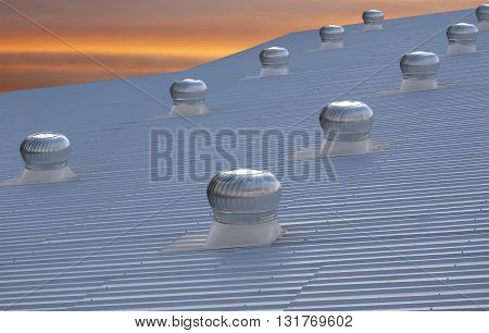 top view of manufacturing factory roof against the evening sky
