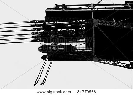 A high-voltage tower with cable winches and platforms.