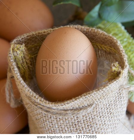 Fresh eggs in and around a hessian bag.
