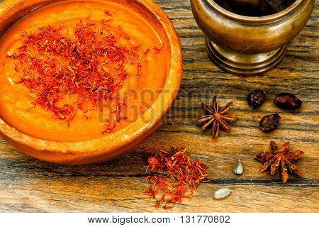 Carrot Cream Soup with Saffron Diet Food. Studio Photo