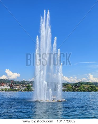 Fountain on Lake Zurich in summertime. Lake Zurich is a lake in Switzerland extending southeast of the city of Zurich.