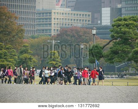 Young students group visiting Imperial Palace, residence of the Emperor of Japan. It is located in Chiyoda, special district 23 Tokyo.