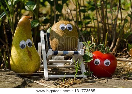 Funny vegetables and fruits with eyes in the summer