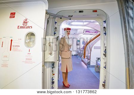 DUBAI, UAE - CIRCA MAY, 2016: Emirates crew member on board of A380. Emirates is one of two flag carriers of the UAE along with Etihad Airways and is based in Dubai.