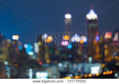 Night lights office building, abstract blurred bokeh background