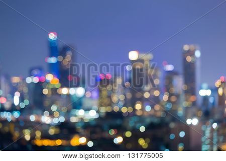 Blurred bokeh night view, office building lights during twilight
