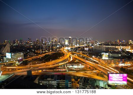 Abstract blurred bokeh lights highway interchanged and city downtown background, night view