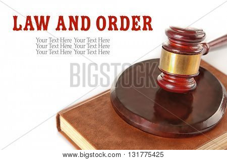 Gavel and book isolated on white. Law and order concept