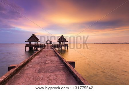 Waking path leading to abandon temple building in the sea