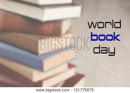 Old books on wooden table, closeup. World Book Day poster