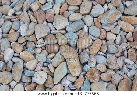 Round stone on the beach, natural background