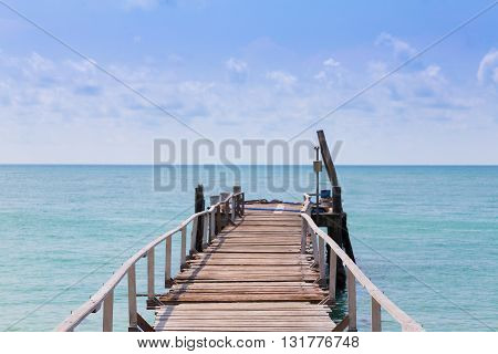 Wooden walkway path leading to the sea, natural skyline landscape background