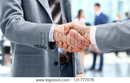 Handshake in front of business people in the offie