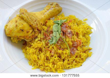 Chicken biryani or rice with curried chicken