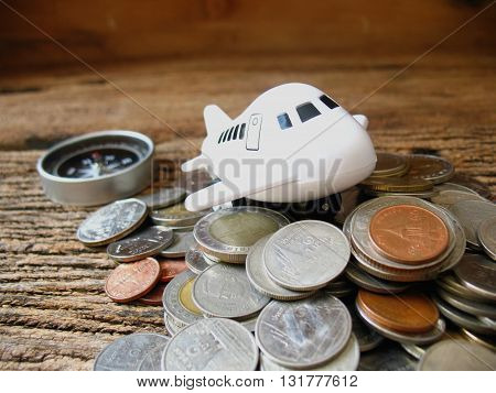 concept idea save money for travel airplane toy to go on top many coin