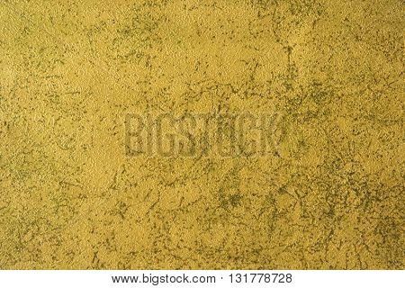 ROUGH WEATHERED WALL , GOLD PAINT, CLOSEUP BACKGROUND