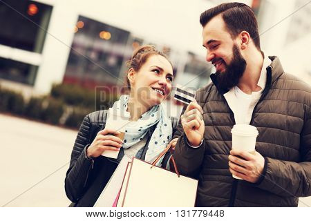 Picture of happy couple shopping with credit card