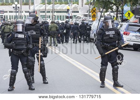 SAN DIEGO USA - MAY 27 2016: Riot police in full tactical gear guard the street to the protest area outside a Trump rally in San Diego.