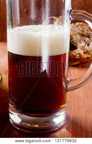 Dark beer in a glass glass on a wooden table