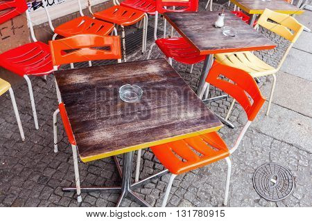 table and chairs of a sidewalk cafe