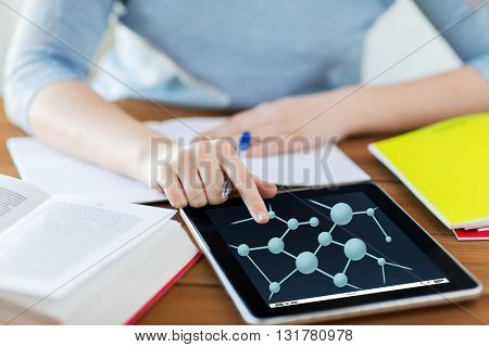 education, science, technology and people concept - close up of student woman with molecule formula tablet pc computer and notebook at home