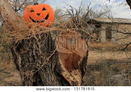 Halloween Jack o Lantern with Creepy Abandoned House in the Background