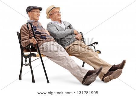 Two relaxed senior gentlemen sitting on a bench isolated on white background