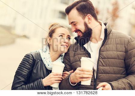Picture of young couple on a date with coffee