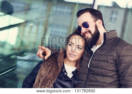 Picture of young couple hanging out and pointing